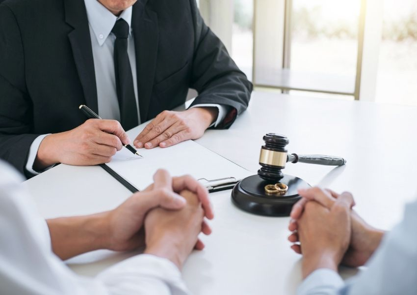 Couple sitting with divorce attorney